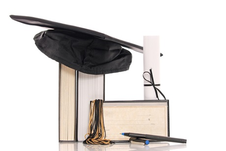 Image of pens, book, scroll and hat